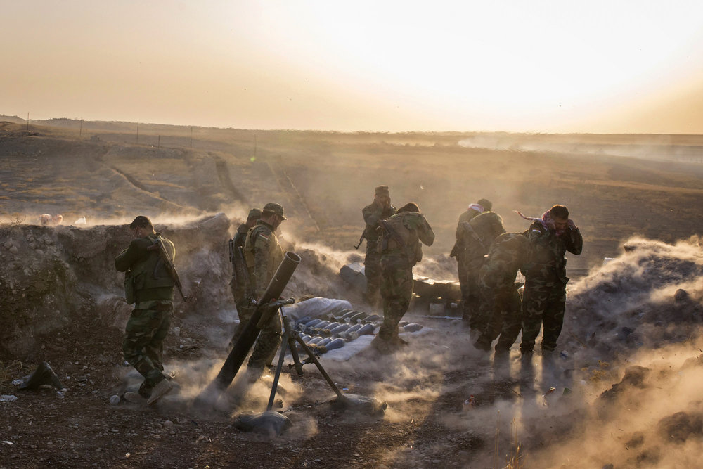 A Peshmerga mortar team fires at Islamic State positions in support of a Kurdish assault.