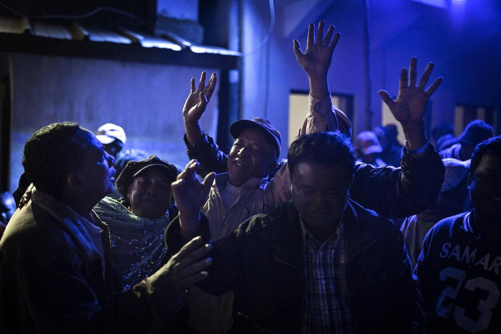 People dance at the Famadihana.