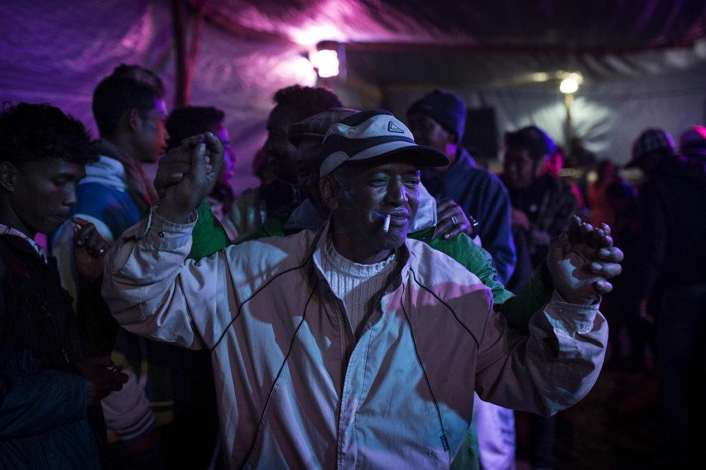 Jules Rakotoarasoa dances at the Famadihana he hosted for his parents.