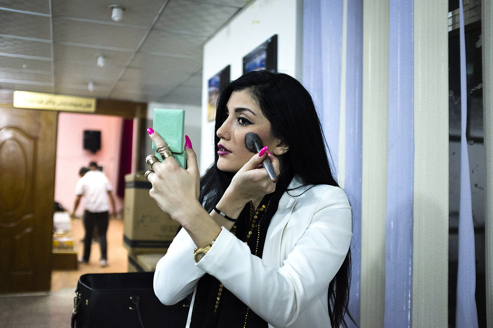 Helly Luv touches up her makeup during a dress rehearsal.