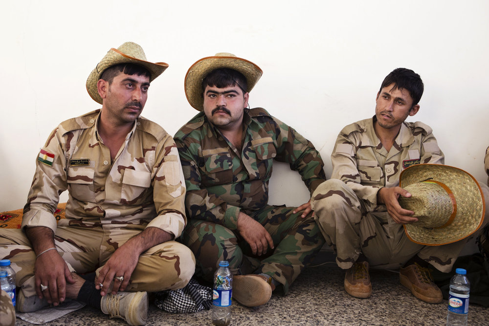 Peshmerga during downtime at a base.