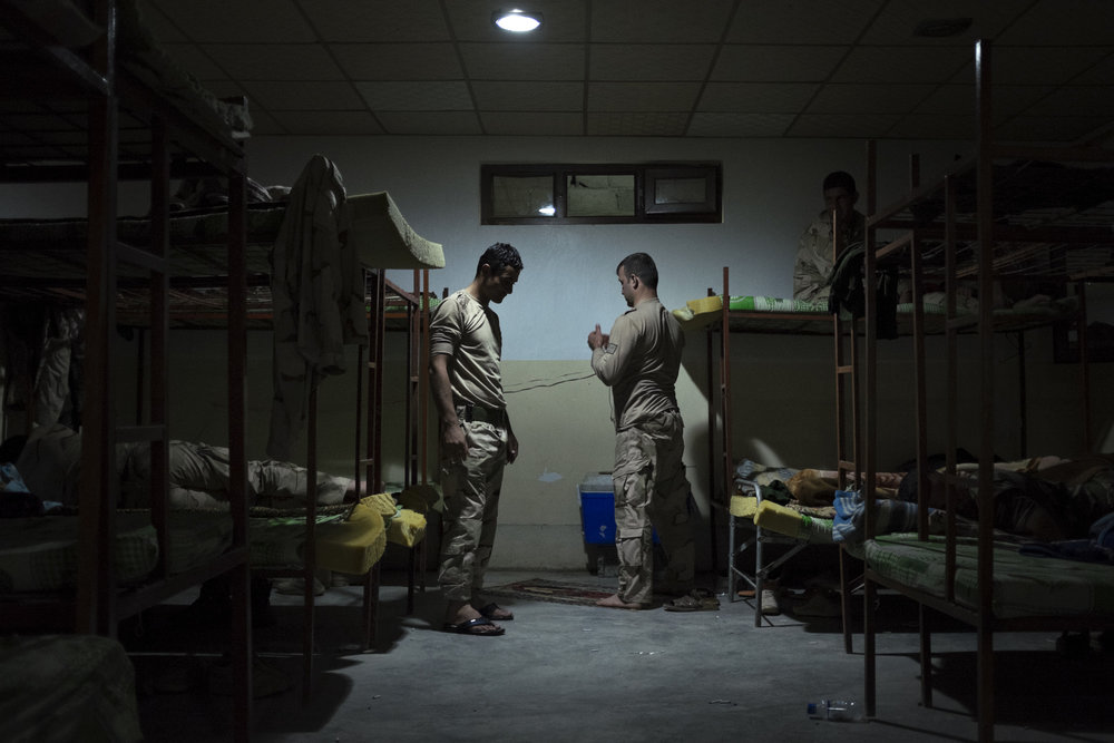 Peshmerga pray before going to sleep.