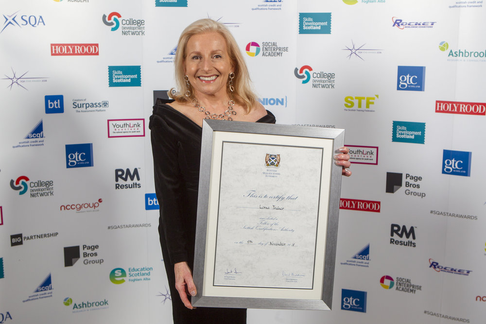our director, lorna trainer, receiving the sqa fellowship award