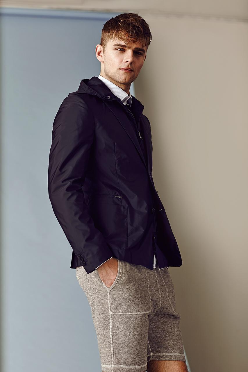 Jacket  PRADA  $1,025. Shirt  TOM FORD  $605. Shorts  SCOTCH & SODA  $109.