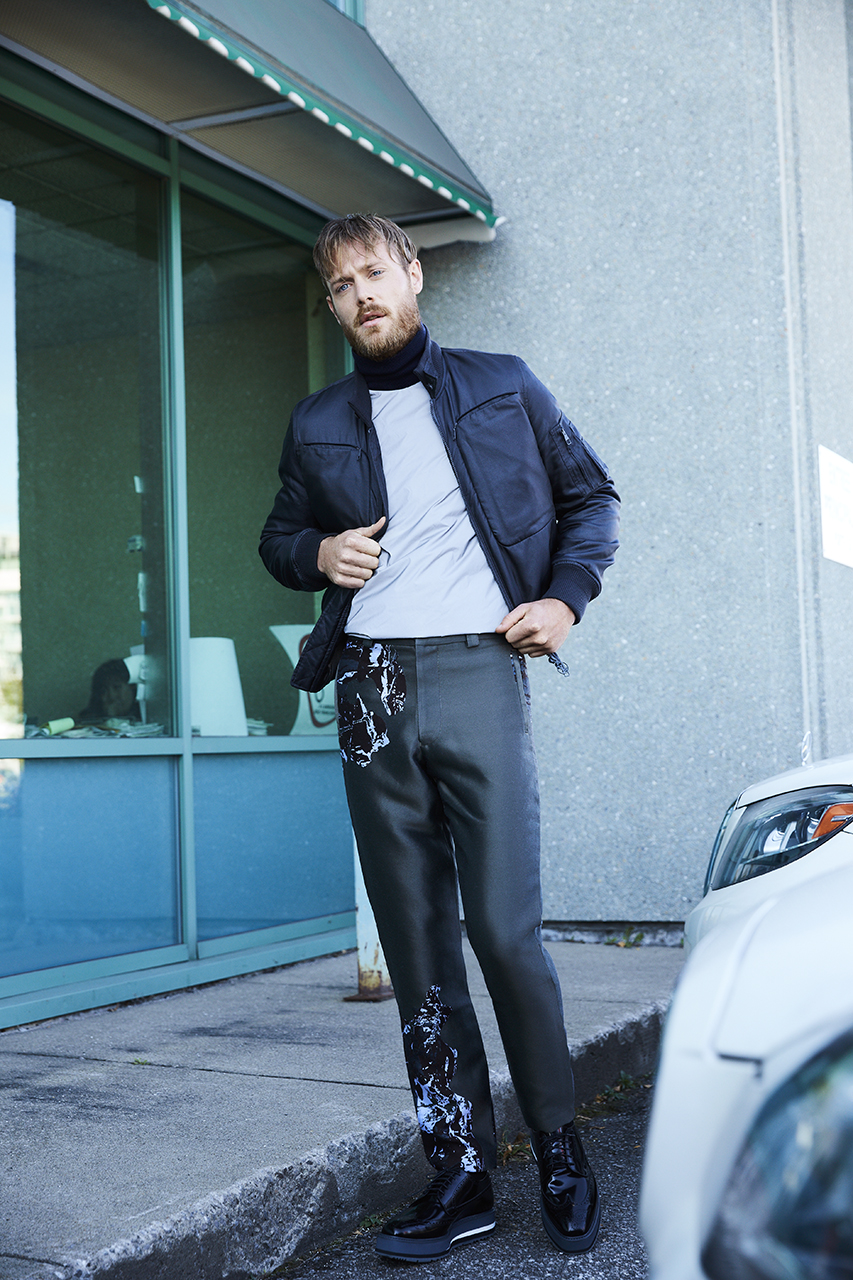 Jacket LOUIS VUITTON $3,250. Shirt COS $175. Turtleneck BRUNN & STRENGADE $125. Shoes PRADA $1,270.