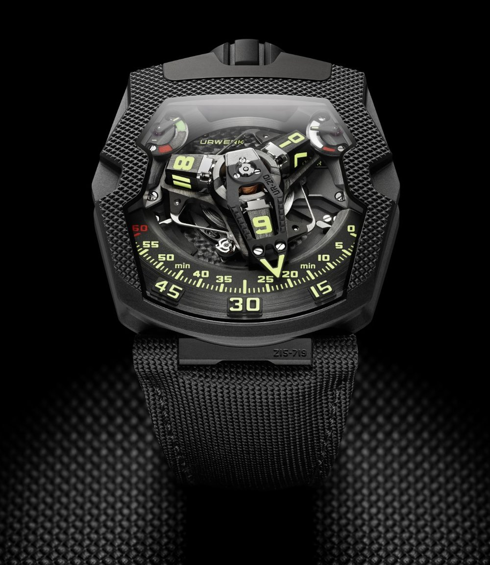 "Urwerk UR-210  It comes to Urwerk, you may be quick to think of the company's last UR-210 model with its revolving satellite hour indicator and horizontal retrograde display. The newly released UR- 210 CP ""Clou de Paris"" is just as impressive, if not more so. While it uses the same UR-7.10, the engine has been reiterated in a darker, quilted skin. The watch's black and textured case finishing imprints this stunning watch in the mind's eye - you'll have to see it to believe it. Movement: UR-7.10 self-winding Case: 43.8 mm x 53.6 mm x 17.8 mm Price: $150,000"