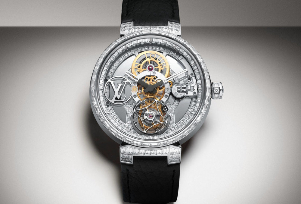 Louis Vitton  Tambour Moon Tourbillon  The Manually-wound Calibre LV 97 reinterprets the Tourbillon with an exceptional 80-hour power reserve. the case and plate are entirely encrusted with diamonds a first for a watch with Poincon de Geneve Certification.   Movement lV 97 Calibre ,Case 42.5 mm  Price: Upon Request.