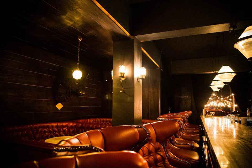 Glossy décor and elegant cocktails await at this dimly lit speakeasy. Tucked behind an unassuming taqueria, RSVPS are a must at Hanky Panky Cocktail Bar.