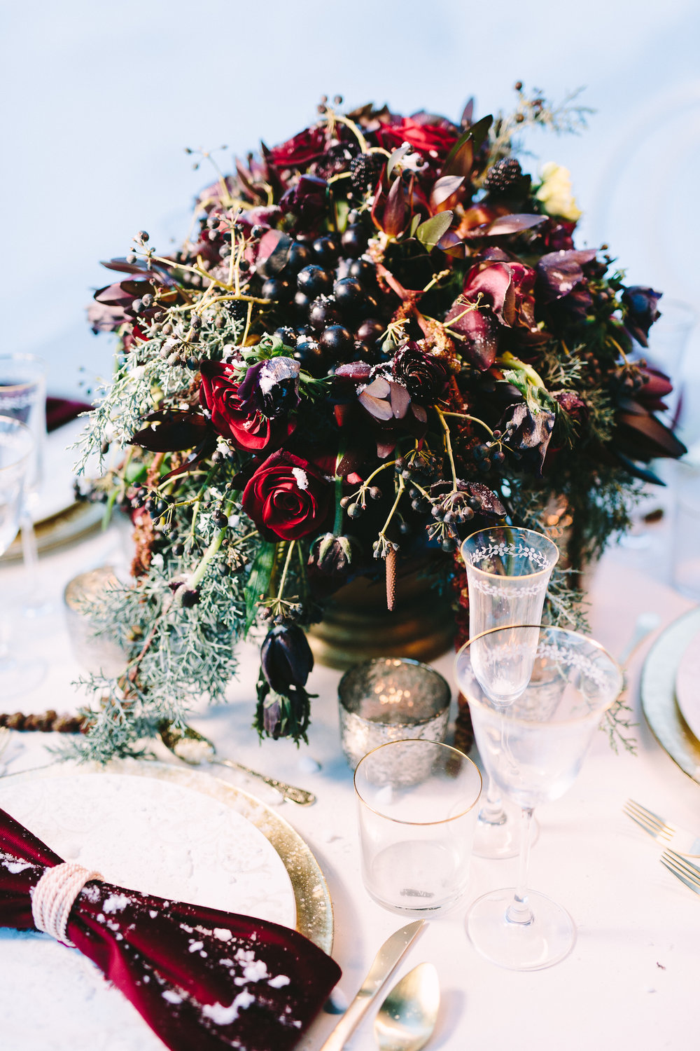 styled-shoot-winter-elatos-resort-greece-destination-wedding-table-luxury-chic-burgundy-white-gold-ring-napkin