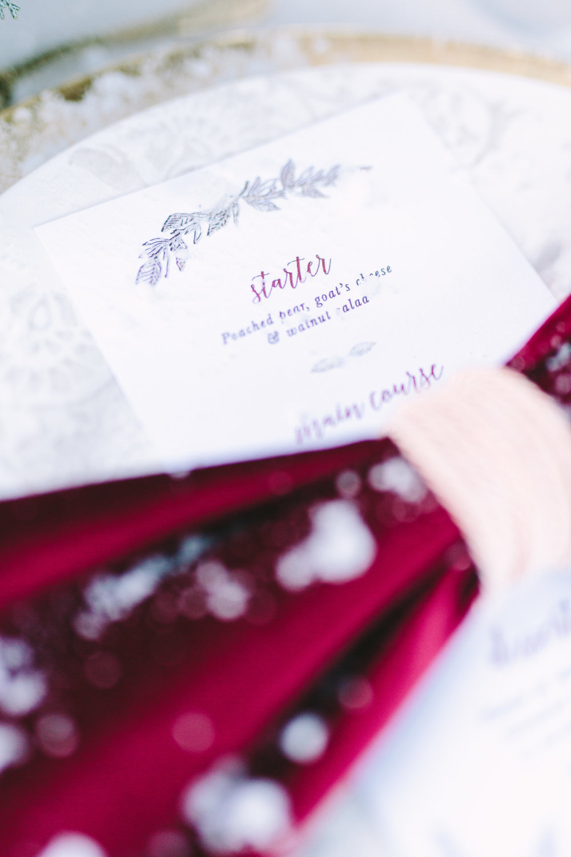 styled-shoot-winter-elatos-resort-greece-destination-wedding-table-luxury-chic-burgundy-white-gold-dinner-menu-stationery-artdelatable