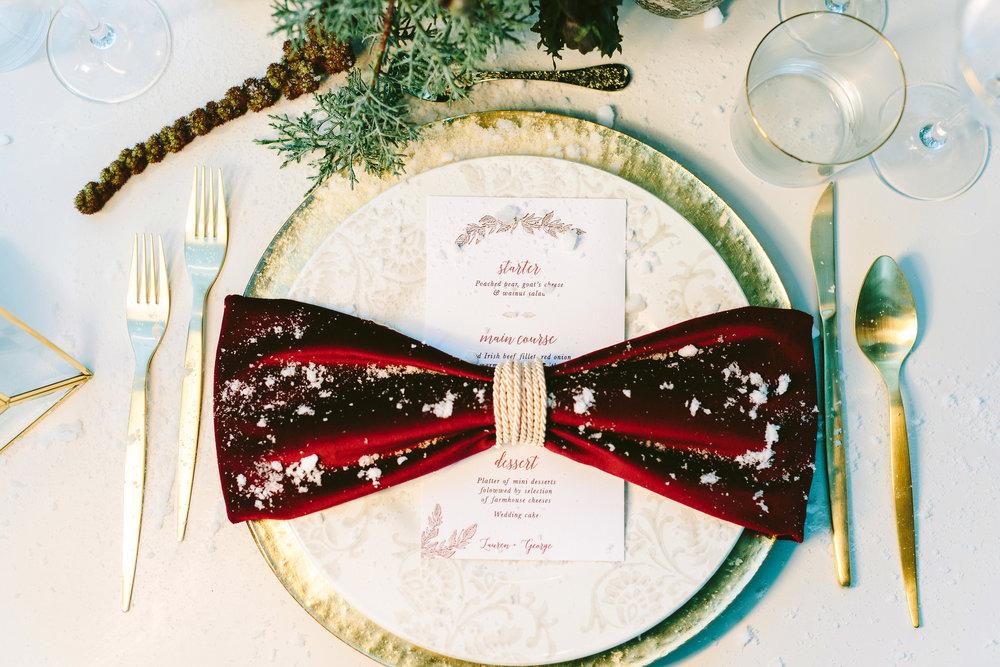 styled-shoot-winter-elatos-resort-greece-destination-wedding-table-luxury-chic-burgundy-white-gold-dinner-crystal-plate-charger-menu-napkin-ring