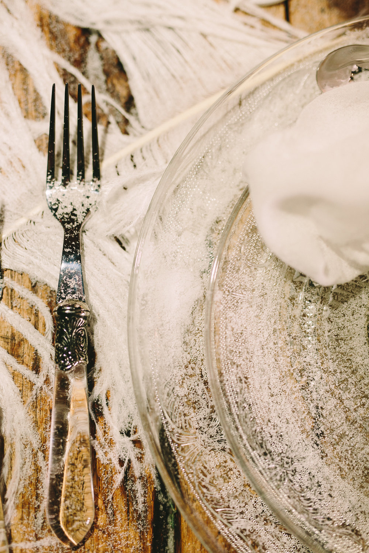 Destination-winter-wedding-greece-wedding-planning-snow-white-feathers-luxury-silver-cutlery-napkin-orchids-escortcards