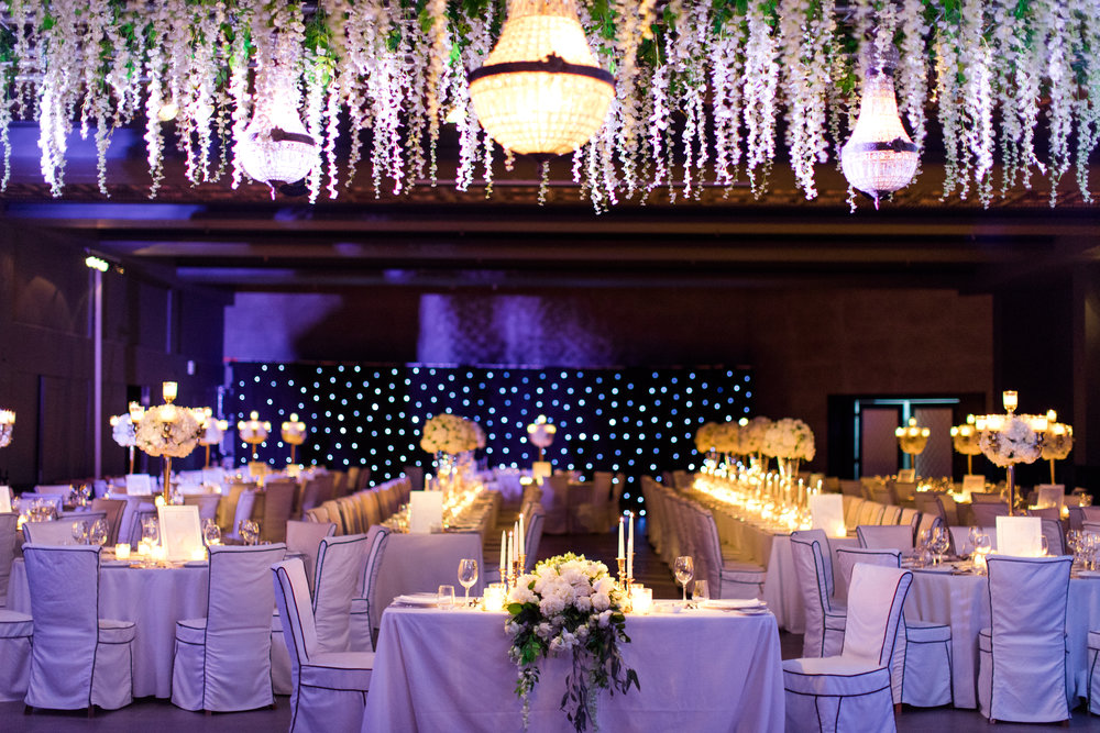wedding-dinner-party-jewish-traditional-menu-luxury-event-decoration-hanging-wisteria-crystal-chandeliers-light-design-table numbers-table-arrangements