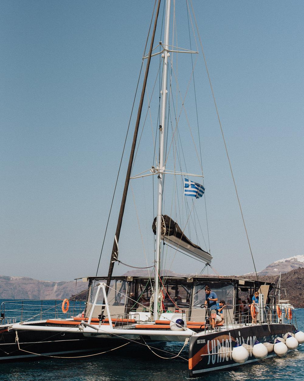 santorini-pre-wedding-destination-catamaran-cruise-party-bride-groom-rocabella-hotel-silkentile-event-planning-firm