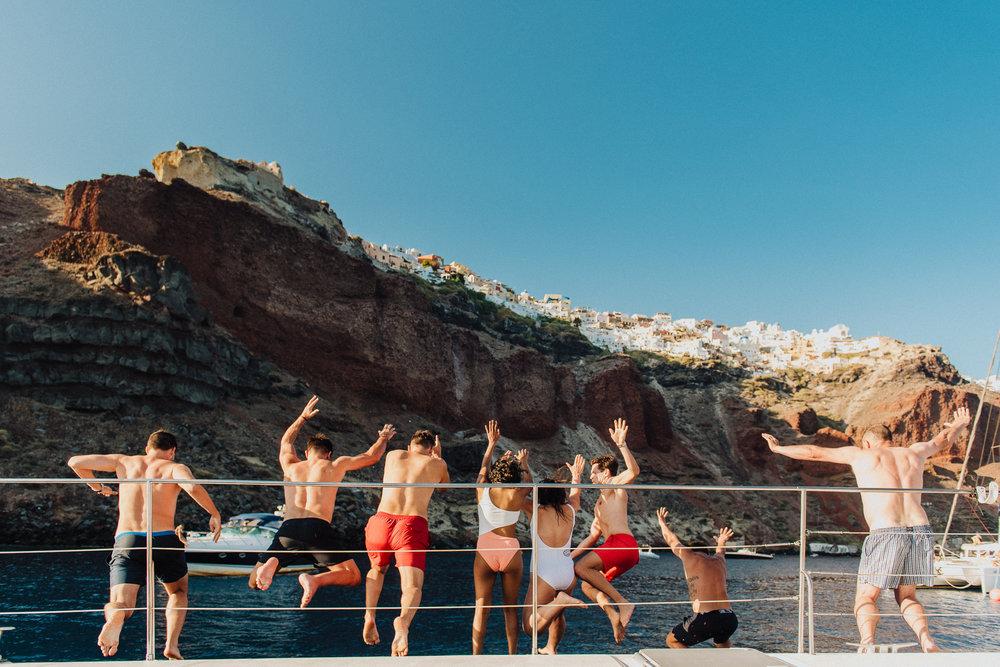 santorini-island-greece-pre-wedding-celebration-beach-hopping-catamaran-cruise-party-bride-groom-rocabella-hotel-silkentile-event-planning-firm