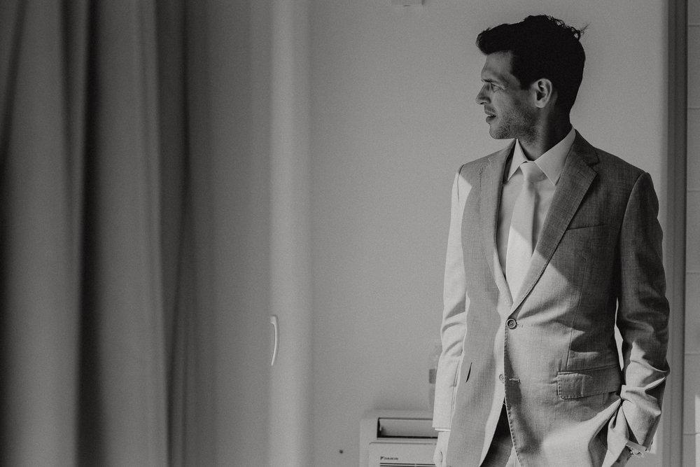santorini-island-greece-wedding-preparation-groom-wedding-stationery-rocabella-hotel-silkentile-event-planning-firm