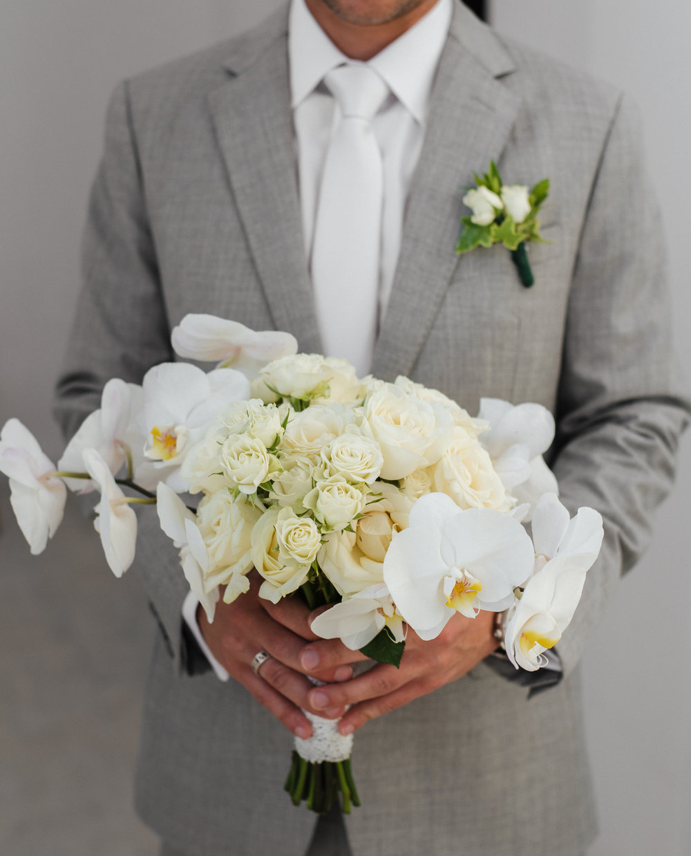 santorini-island-greece-wedding-celebration-ceremony-bouquet-white-orchids-white-roses-groom-bride-rocabella-hotel-silkentile-event-planning-firm