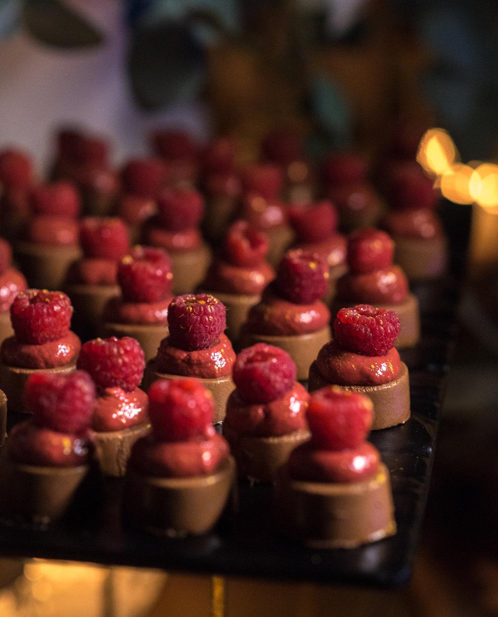 santorini-island-greece-wedding-dinner-celebration-groom-bride-sunset-wedding-table-crystal-charger-plate-flower-arrangement-dessert-table-fairy-lights-mini-bulbs-rocabella-hotel-silkentile-event-planning-firm