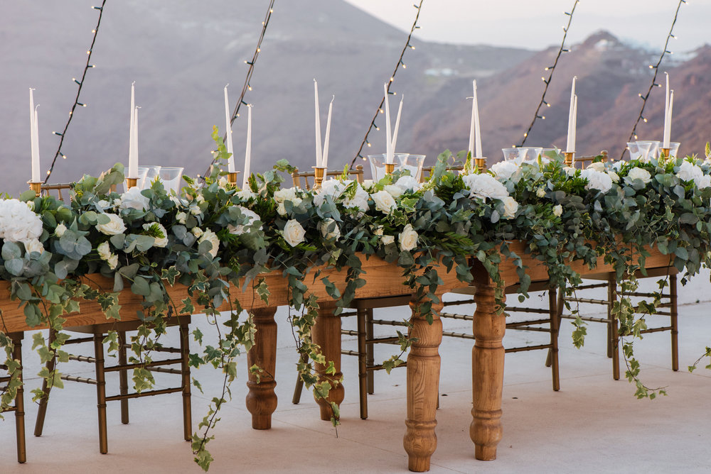 santorini-island-greece-wedding-dinner-celebration-ceremony-groom-brid-sunset-wedding-table-arrangement-rocabella-hotel-silkentile-event-planning-firm