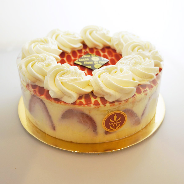 Fraisier   Ladyfinger sponge cake soaked with strawberry syrup, layered with vanilla Crème Madame and fresh strawberries (seasonal, special order). Gluten-free.