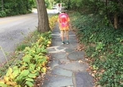 Walking on a sidewalk in Swarthmore