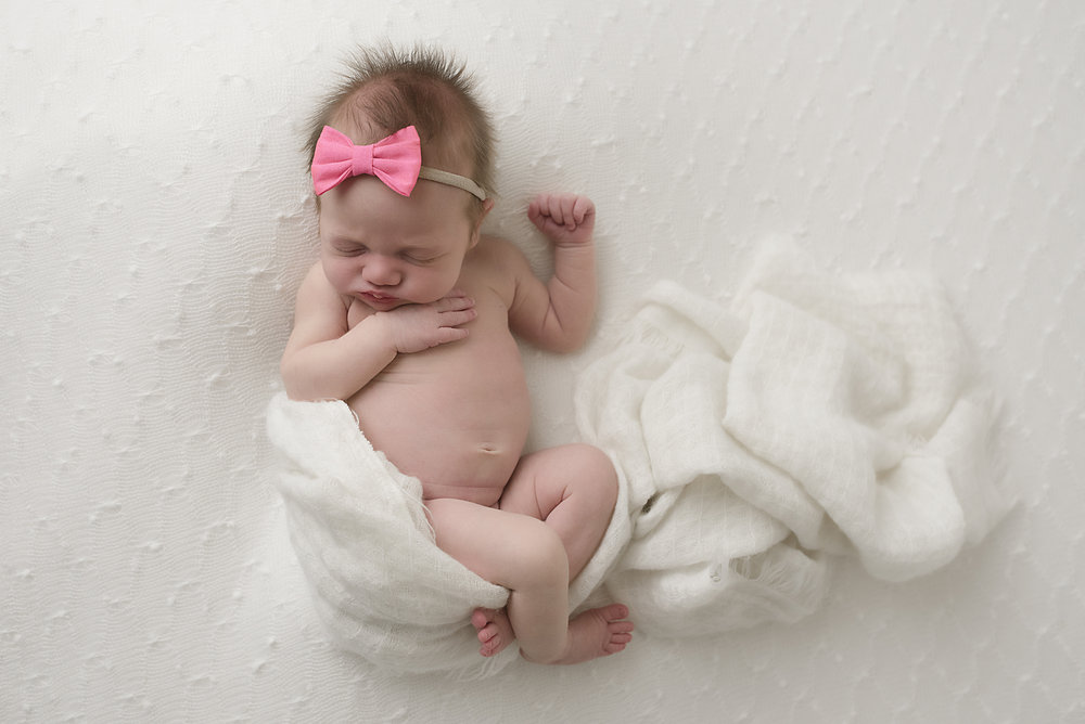 Columbus ohio newborn photographer natural baby led posing all white