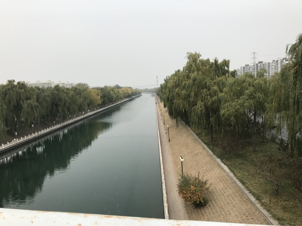 Canal under a bridge on the way to Youyi Shopping City