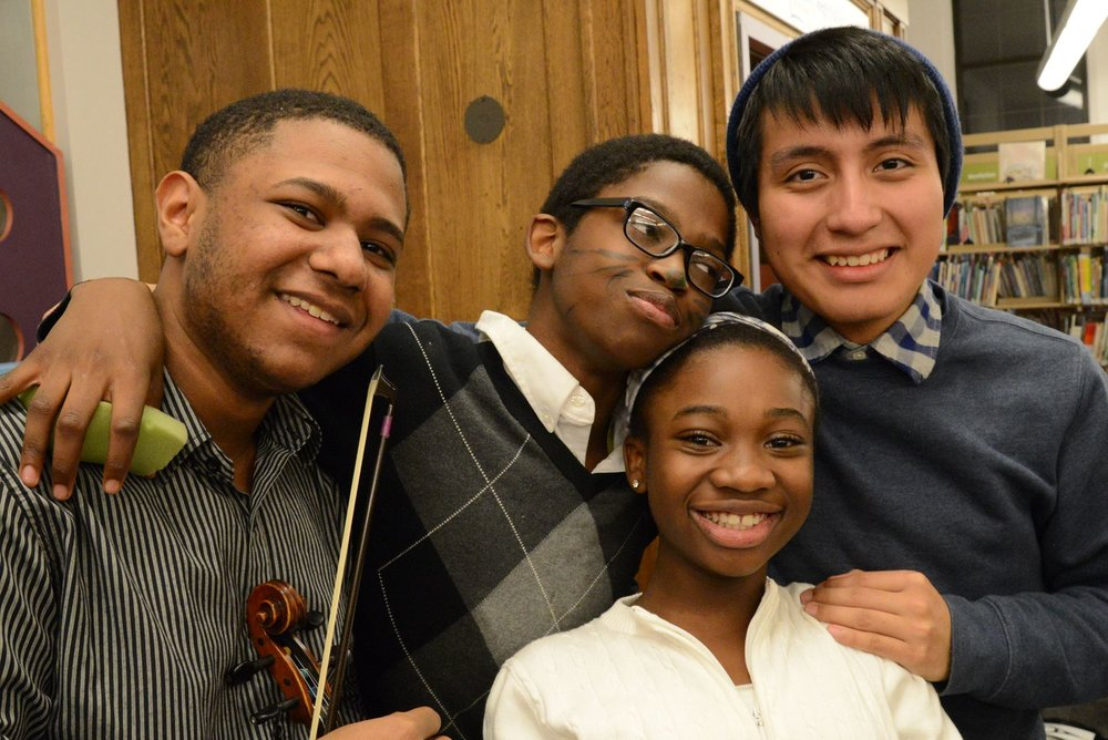 Robert with some of his Music Haven friends, Noel, Lihame, and Cris, at the Spring 2016 studio recital at the Fair Haven Library Branch.