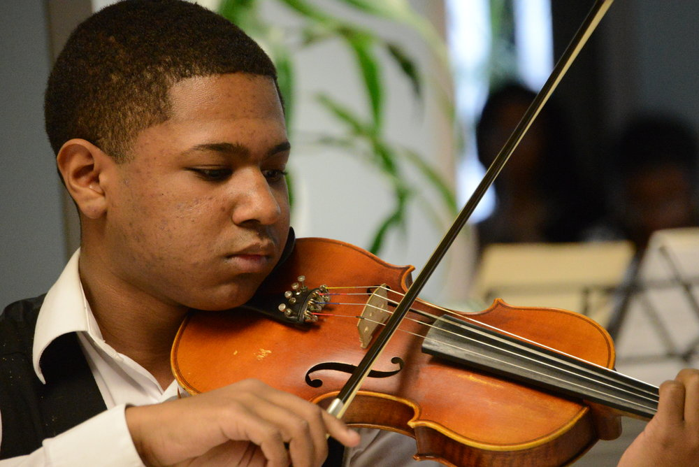 Violin student, Noel, at the 2015 concert.