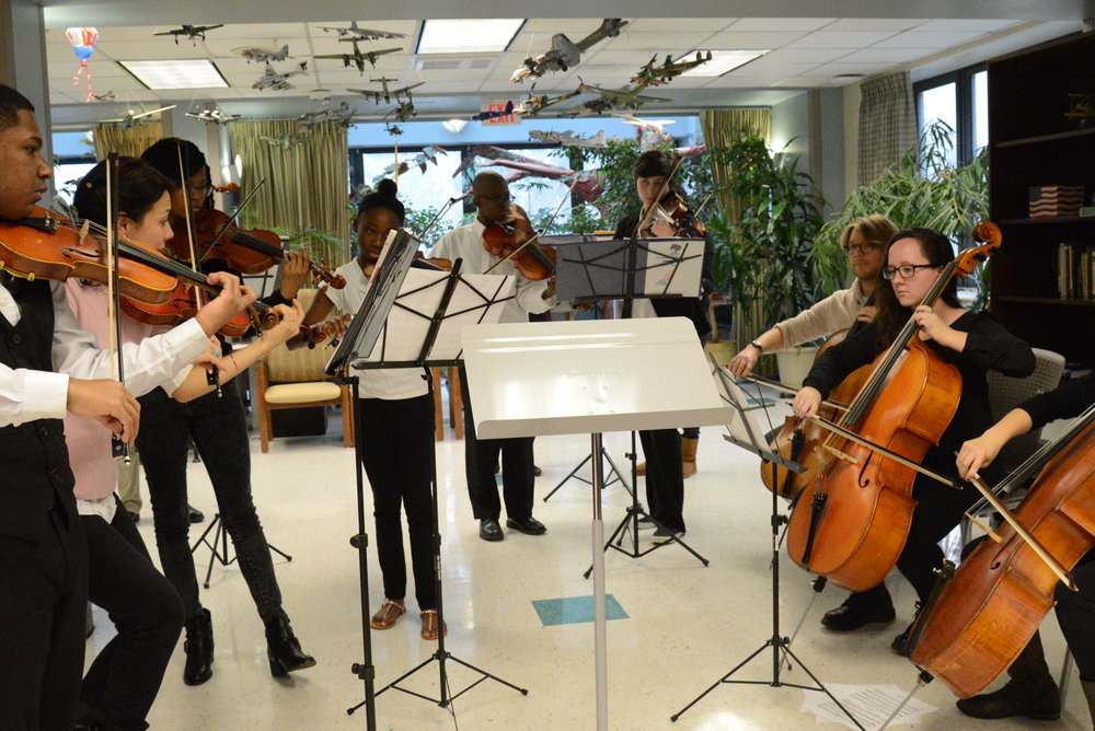 Music Haven's student orchestra, Harmony in Action, at the 2015 concert.