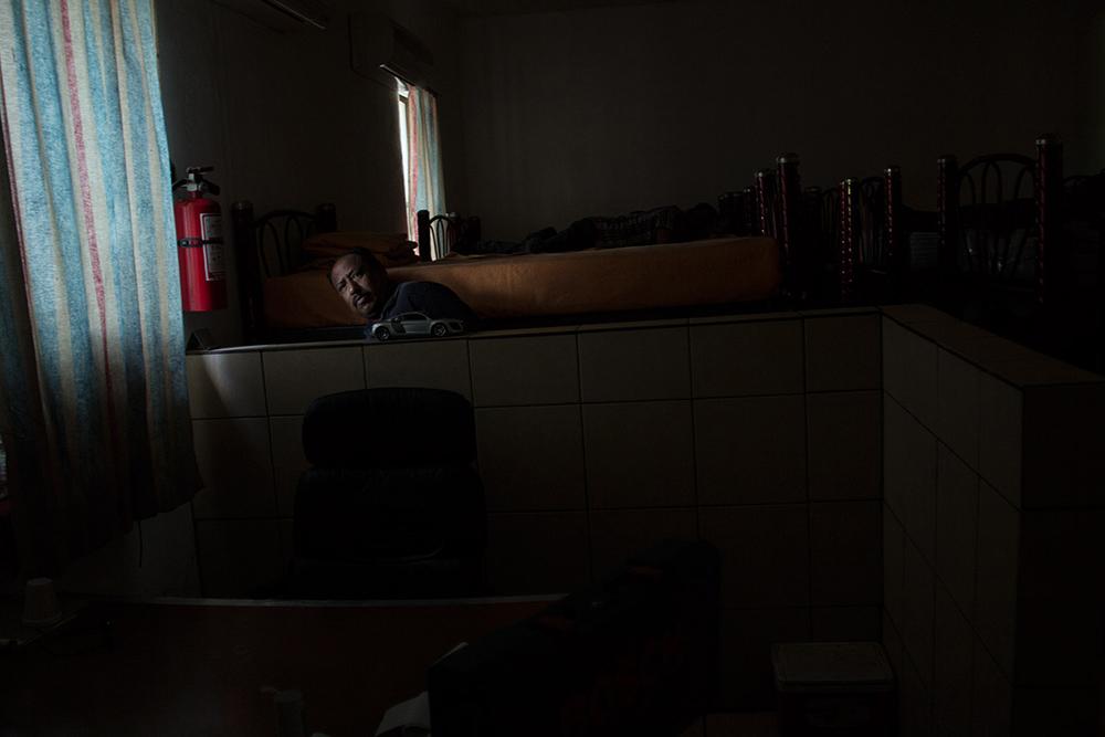 RolandoPalacio_Nogales_Sonora_Mexico_ShelterVoluteerPreparingForMigrants_2013.jpg