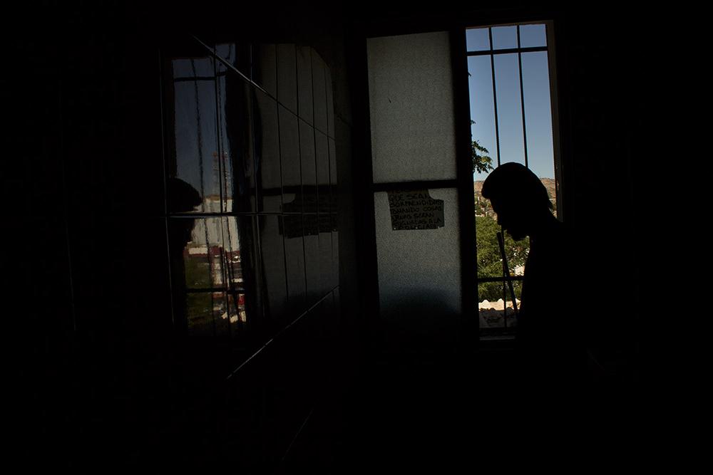 RolandoPalacio_Nogales_Sonora_Mexico_YoungManCleaningUpInBathroom_2013.jpg