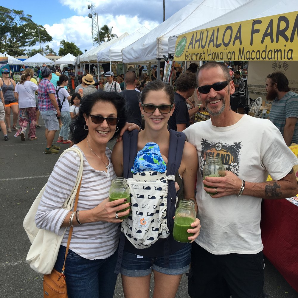 Mom and dad here for two weeks! Slamming green drinks at the Kailua Town Farmer's Market.