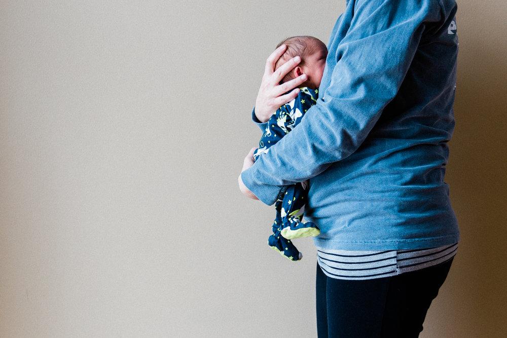 """""""40 weeks"""" holding a one week old Mikko James"""