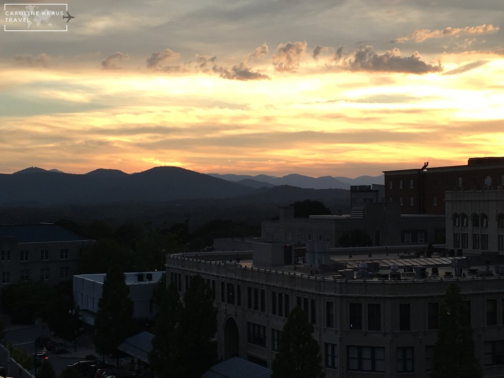 View of the sunset from the rooftop bar at The Montford
