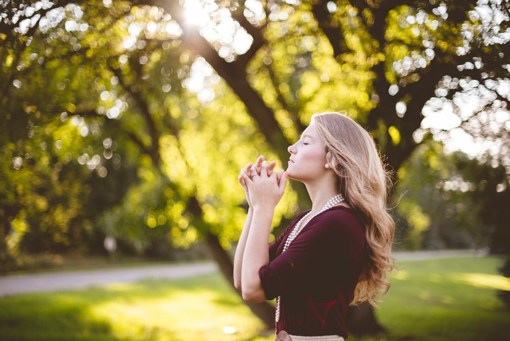 praying Christian woman outdoors