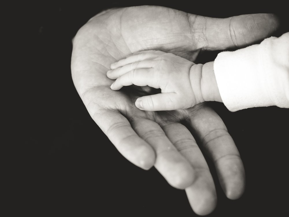 baby hand in elderly hand