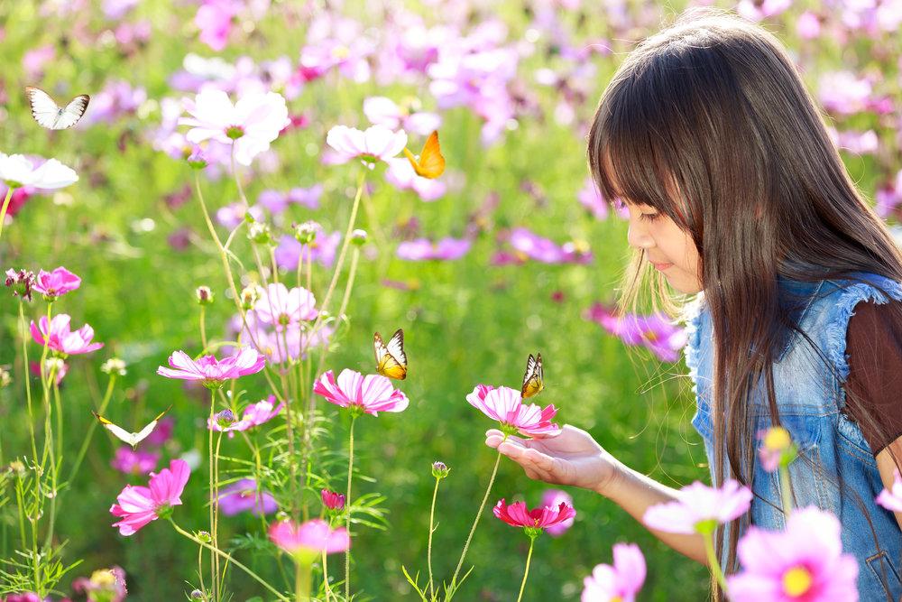 bigstock-Little-Asian-Girl-In-Flower-Fi-57118544.jpg