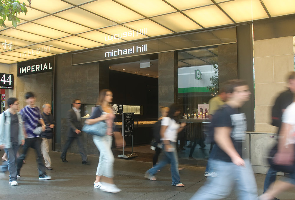 Background   As one of New Zealand's best known brands, Michael Hill Jeweller was renowned for its groundbreaking innnovation in an otherwise very traditional sector.    The retail brand was shifting gears and aspirations with plans to expand further into the Australian and North American markets. The need to elevate the shopping experience above the standard retail environment and become more premium aspirational required a new brand mark and collateral to reflect this new position, without losing their core customers.
