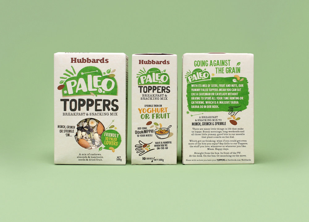The Toppers family of DIY breakfast and snacking mixes were developed by Hubbards to target specific groups of consumer preferences. The foodie style mixes were the ideal extension for a market challenger.    In step with current trends, the smaller snack pack format with product display window allows the natural ingredients to speak for themselves. Bright coloured, hand rendered typography and quirky graphic lock ups add a sense of energy and help to navigate the range of product mix propositions. Toppers are an exciting onshelf proposition, each having its own 'small batch' crafted voice, evoking a bespoke range that sits comfortably within the Hubbards family of cereals.