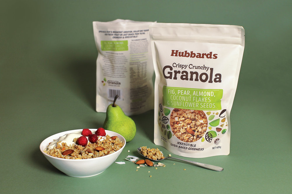 The existing high end premium granola brands already defined the category pack format - the stand up pouch with product window. By adopting this category convention, Hubbards could leverage the artisan properties of the competition and allow the ingredients to be the hero of the pack.    The off white substrate is a crisp, modern backdrop for a simple pack hierarchy, using bold pops of colour for the navigation tags. The yum factor of the product window is enhanced with bursts of whimsical, earthy and abstract ingredient illustrations.    Pack copy centres around 'Crafted with Care', to highlight the café inspired flavours and ingredients crafted in the Hubbards kitchen.A compelling story and premise that has been used in store and social media to create an artisan, foodie buzz.