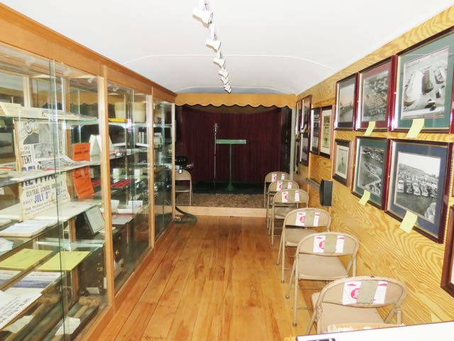 Display cases hold artifacts and Revival memorabilia
