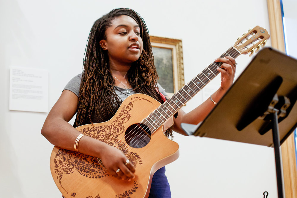 """Kayla DeSouza performs at the first Art Remastered event at Krannert Art Museum in May 2017. Local musicians composed new songs in response to a piece of art at the museum, then performed them next to the artwork. The museum will host an Art Remastered event."""