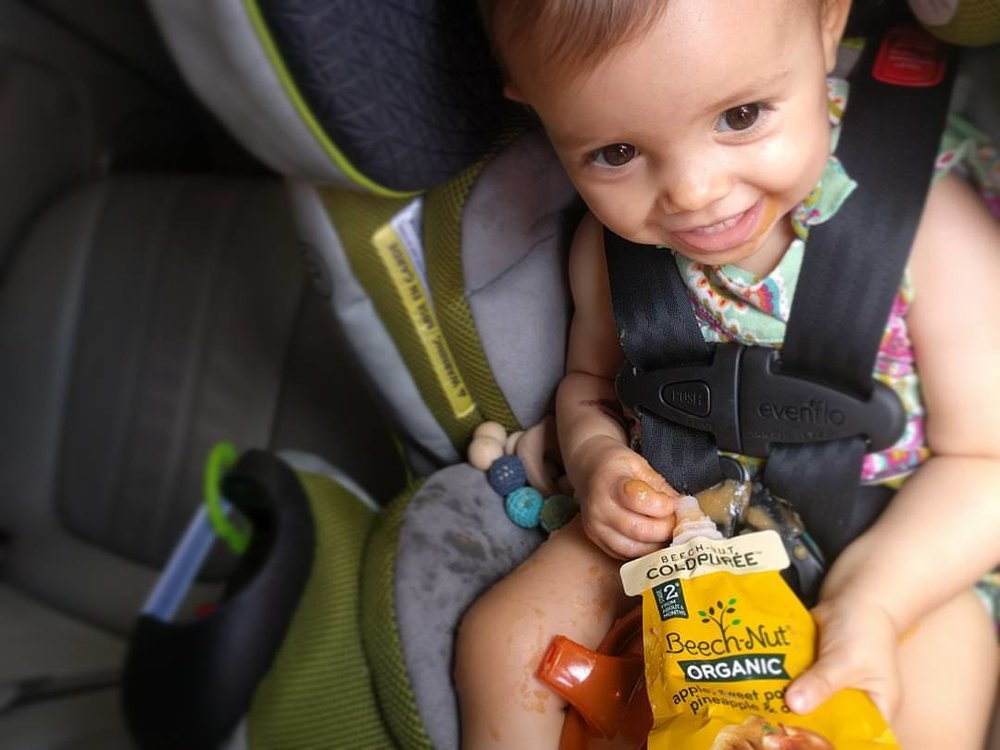 Squeeze pouch snack in the car... mom fail or inevitable moment?