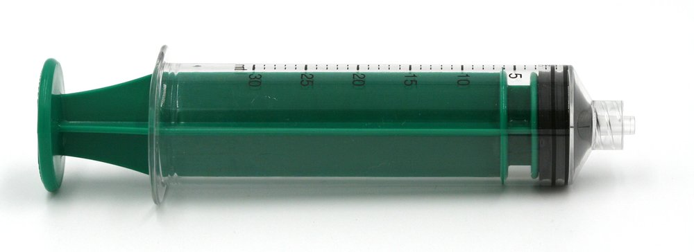 Polycarbonate 30ml syringe in green. Click for detail.