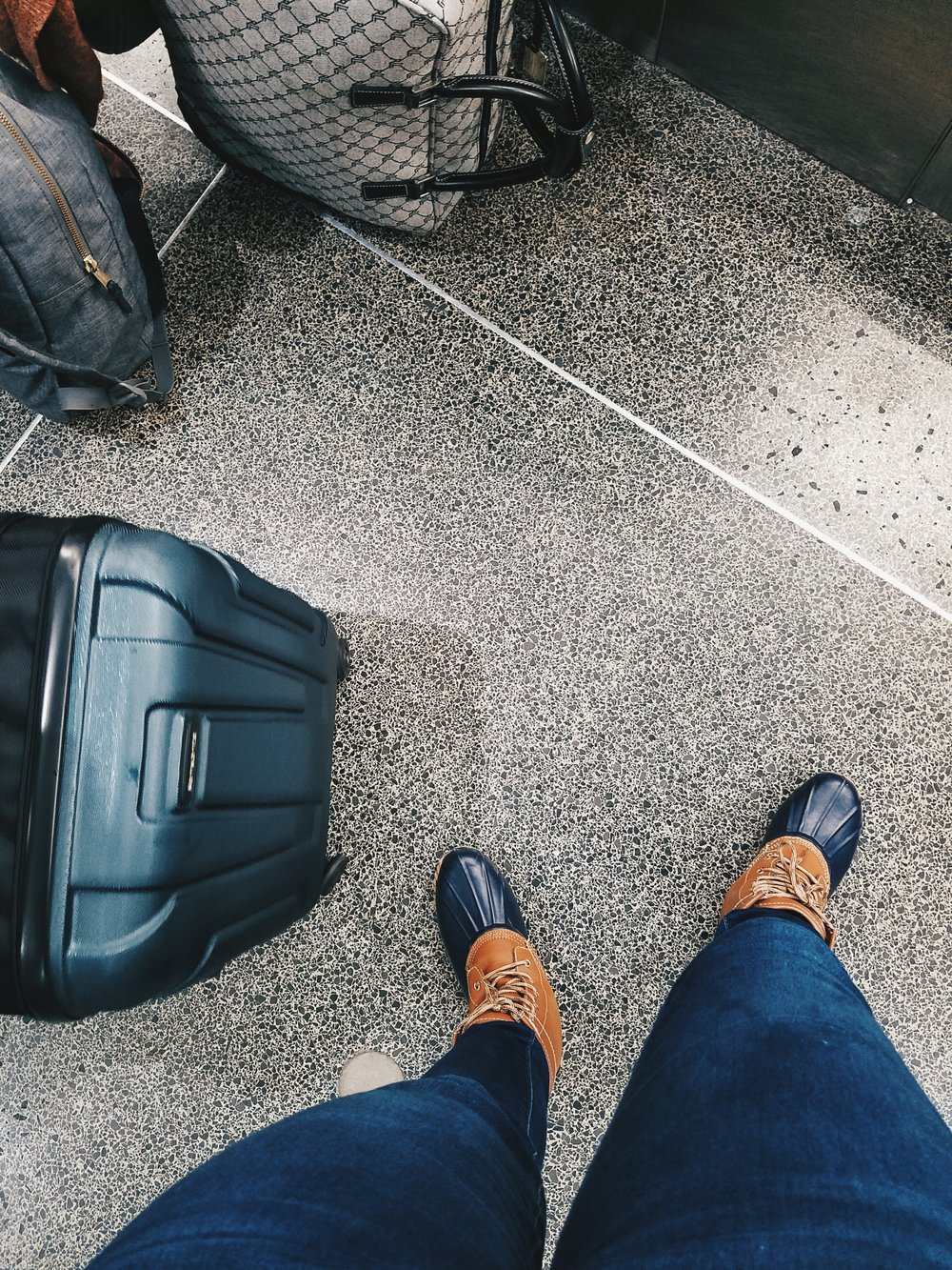 Friendly reminder that you'll have to take off your shoes as part of security. If weather permits, sandals make a much better option than rain boots.