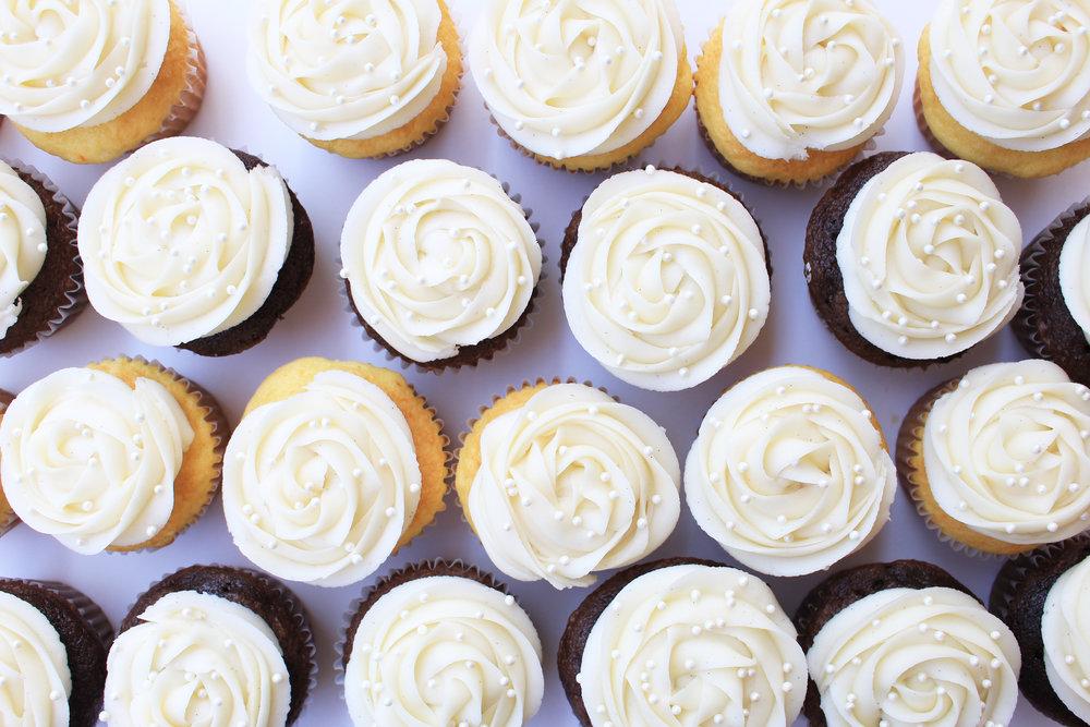 Cupcakes: $20/dozen Vanilla or chocolate cupcakes decorated with vanilla buttercream