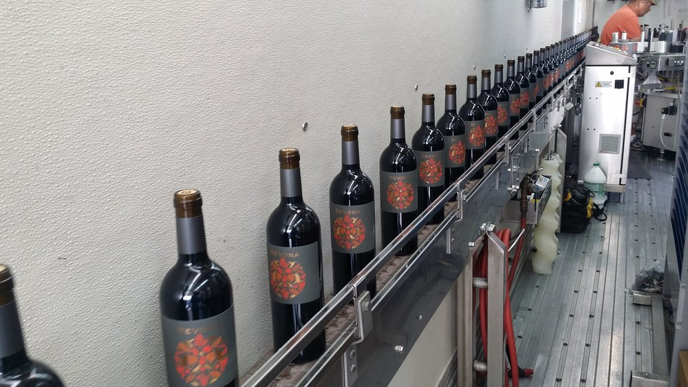 Look at this beautiful new version of our label - 2015 Cabernet Sauvignon on the bottling line. Release date: Fall 2019.