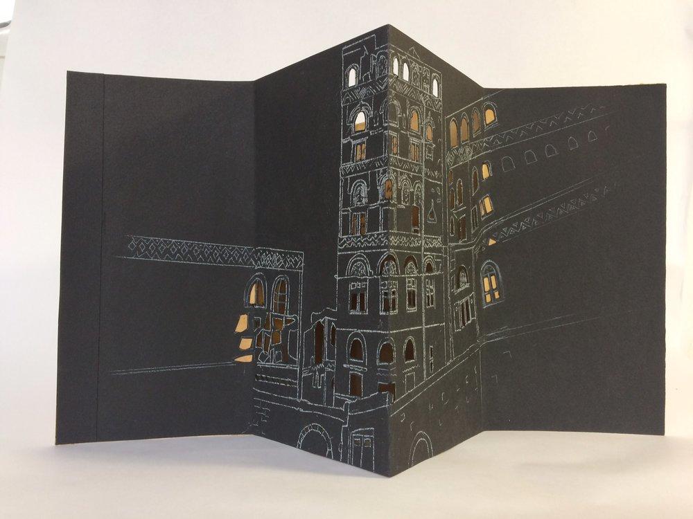 Liz Jeneid,  The hidden War - San'a House 1 , 2017, paper, chalk, shellac, text, 26 x 47 x 17cm