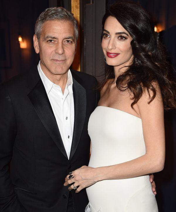 Pregnant Amal Clooney with George Clooney, via Refinery 29.